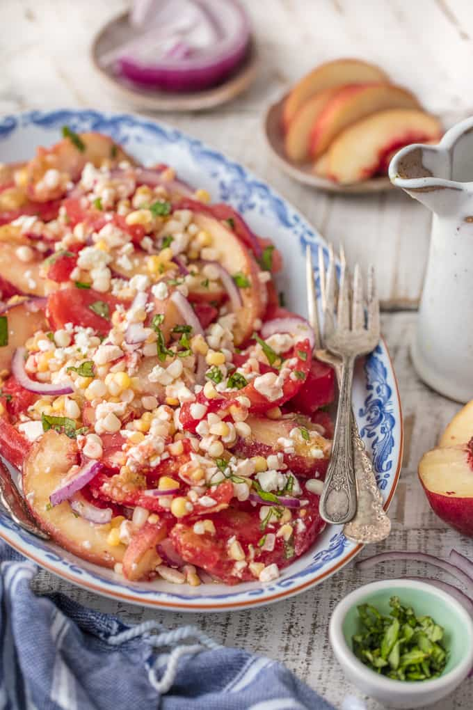 Corn, tomato, onion, feta, peach salad with spicy honey vinaigrette