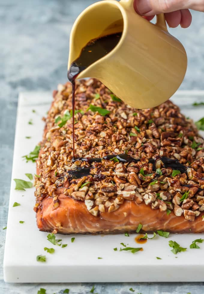 Honey Bourbon glaze being poured over Pecan Crusted Salmon