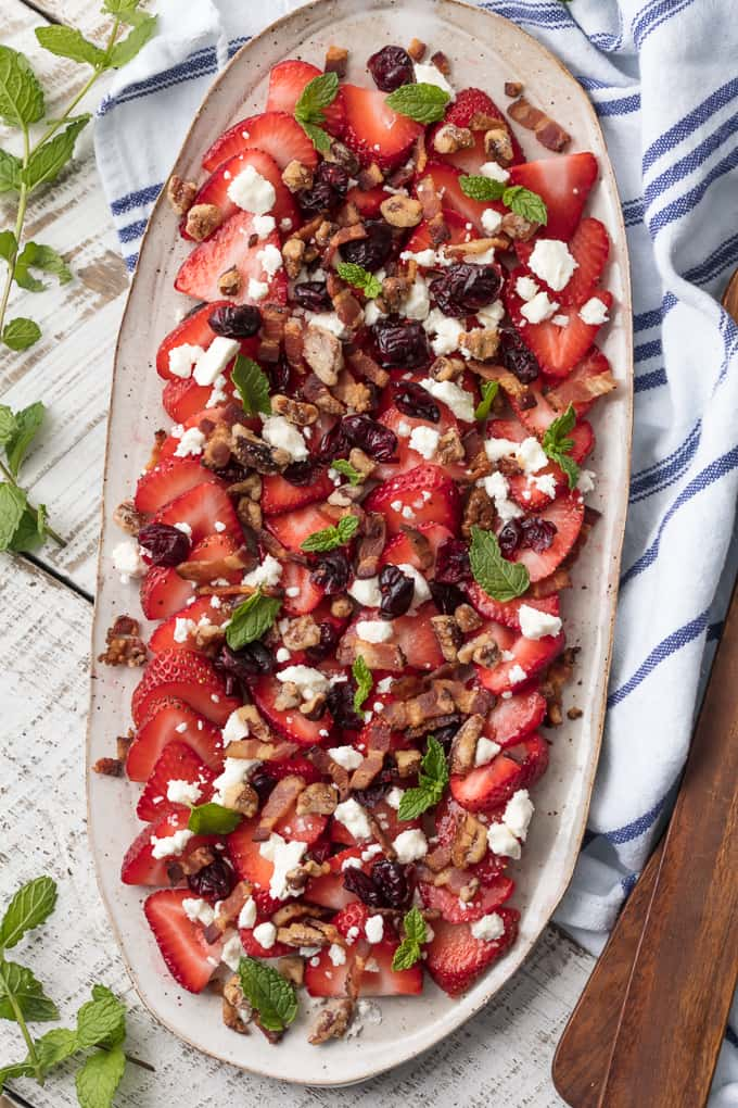 This STRAWBERRY BACON SALAD with LIME HONEY BALSAMIC VINAIGRETTE is utterly delicious and oh so flavorful. You won't believe how the mint pops! Salty and sweet at its best! You won't believe how the mint pops.