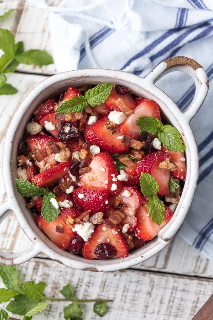 Strawberry Bacon Salad with feta, dried cranberries, pecans, mint, and balsamic vinaigrette