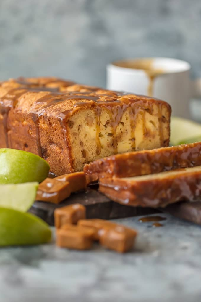 This CARAMEL CHEESECAKE STUFFED APPLE BREAD is a must make for Fall and the holidays. This moist apple bread is more like a chunky apple cake, stuffed with real apples, caramel pieces, and caramel cheesecake. OBSESSED.