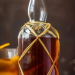 HOMEMADE SPICED RUM is so much easier than you think, and will blow you away with all the flavor! So much tastier than buying in store. This Homemade Spiced Rum makes an awesome DIY Christmas gift! cocktail photography drink photography cookbook photographer