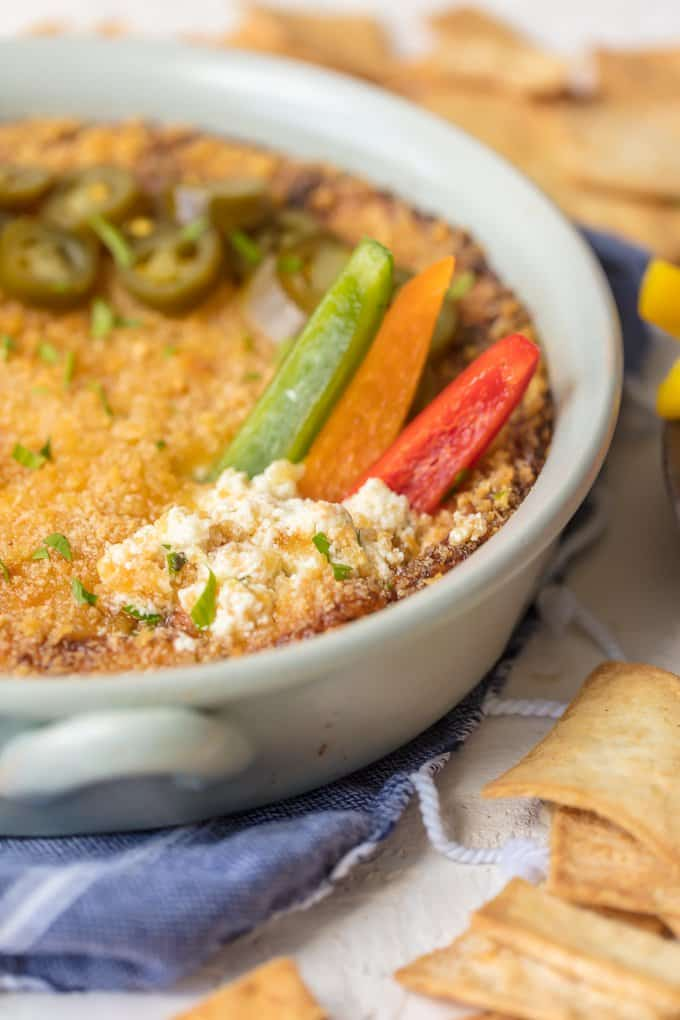 Hot dip recipe with jalapenos and bell peppers on top