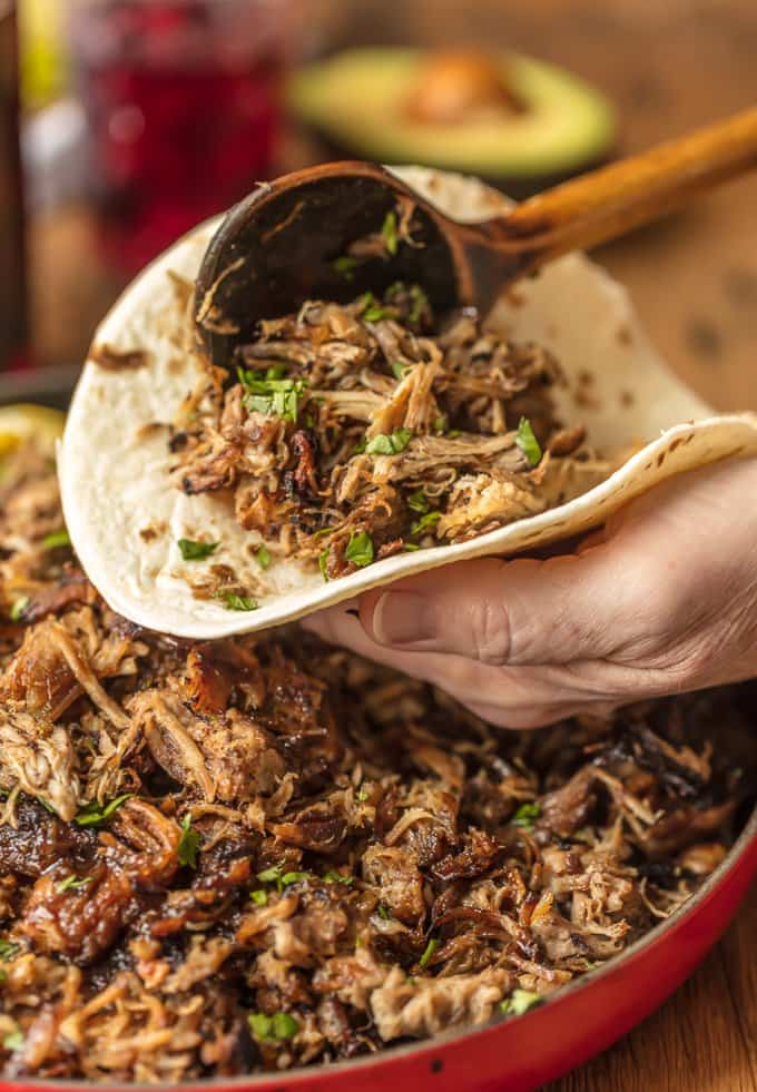 The amazing SANGRIA PORK CARNITAS are made in a slow cooker and finished in a skillet, making them crispy, juicy, and unique. The flavor is out of this world! Eat them on their own, over rice, on nachos, or as tacos! You can't go wrong, except for not trying this recipe.
