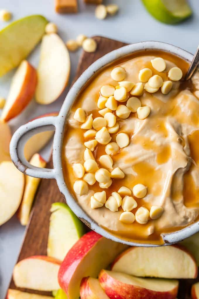 SKINNY CARAMEL APPLE DIP is what every party needs! This lightened up version of our favorite sweet snack is gone in minutes every time.