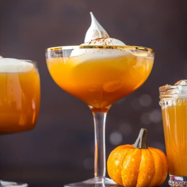 This PUMPKIN PIE PUNCH is the ultimate Thanksgiving cocktail! With apple cider, real pumpkin, and cream soda you'll never believe how tasty this party punch can be. Such a unique and fun holiday drink recipe.
