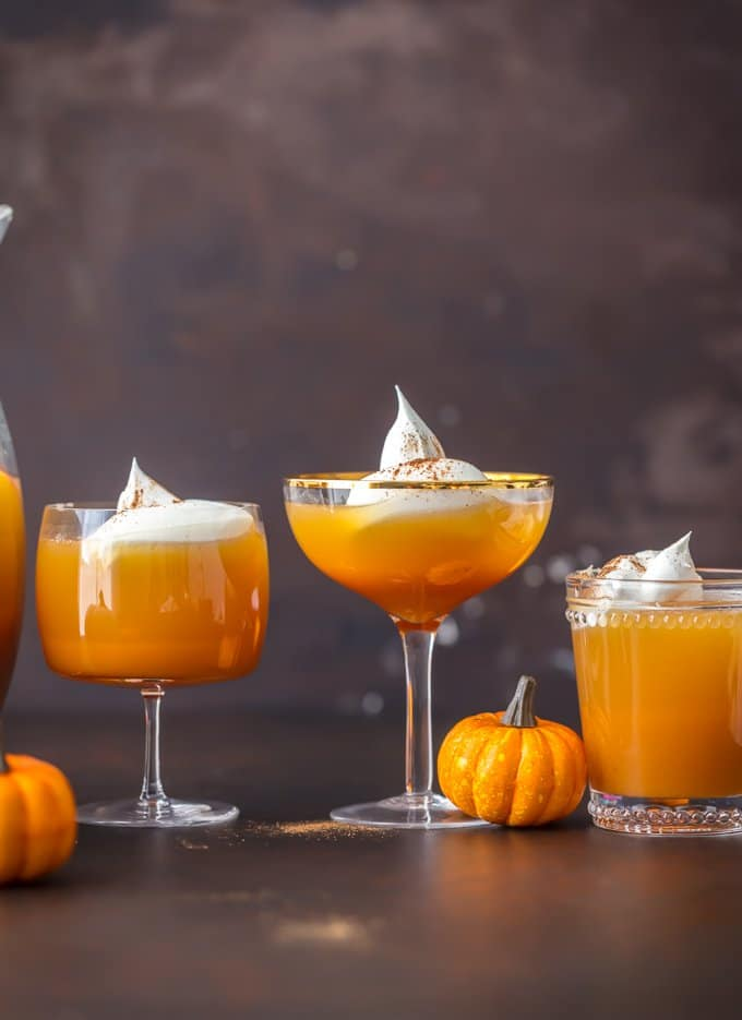 Glasses of pumpkin cocktails topped with whipped cream