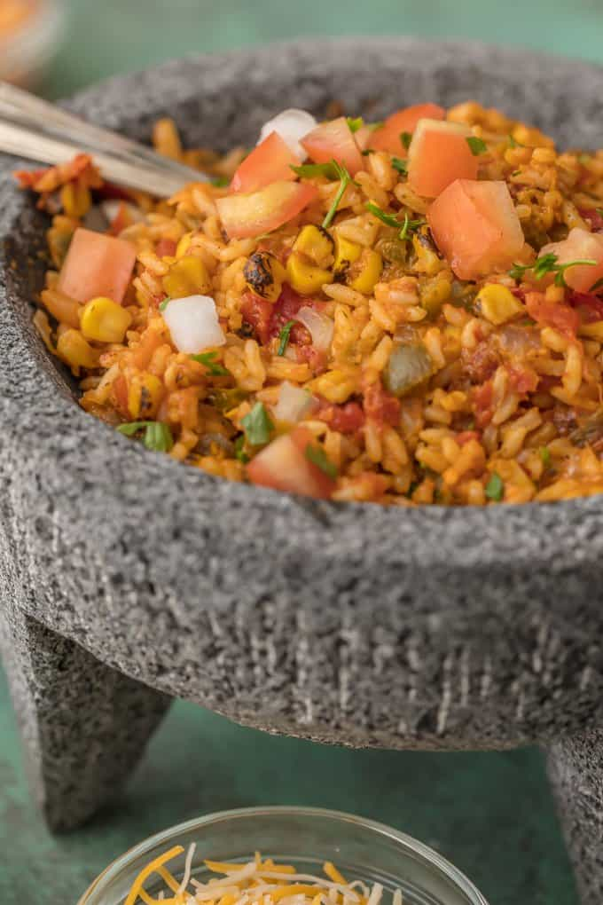 Cheesy Mexican rice with tomatoes, corn, green chiles, onions, and more