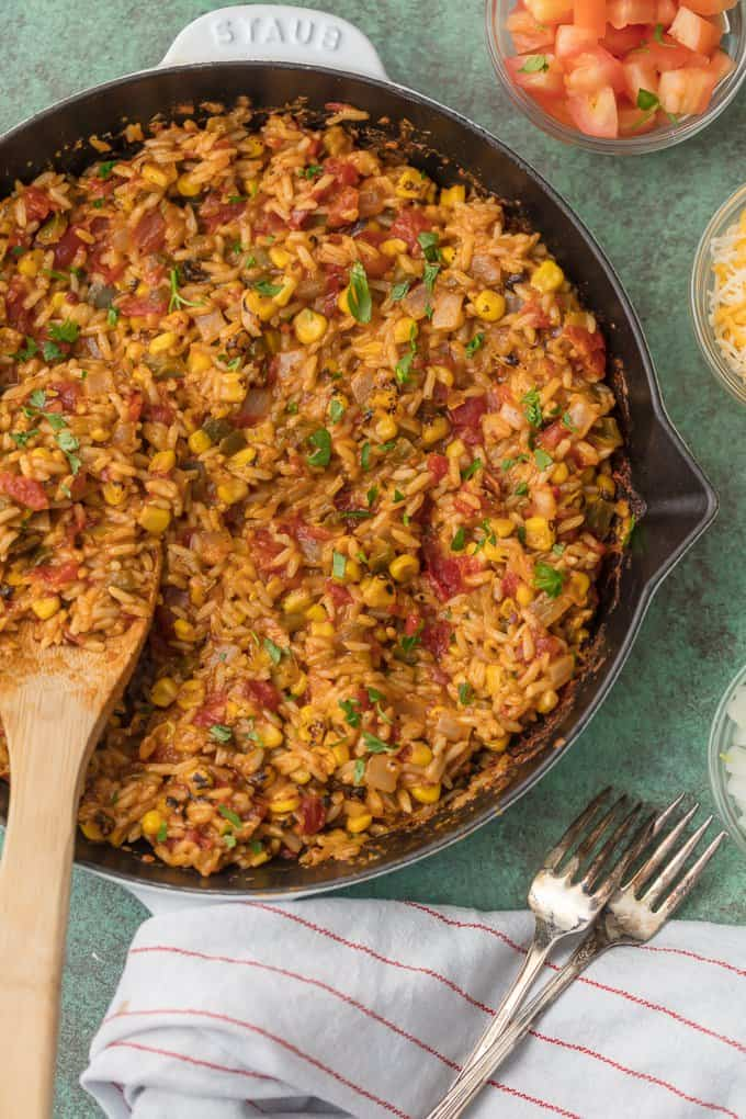 Large skillet full of cheesy easy Mexican rice