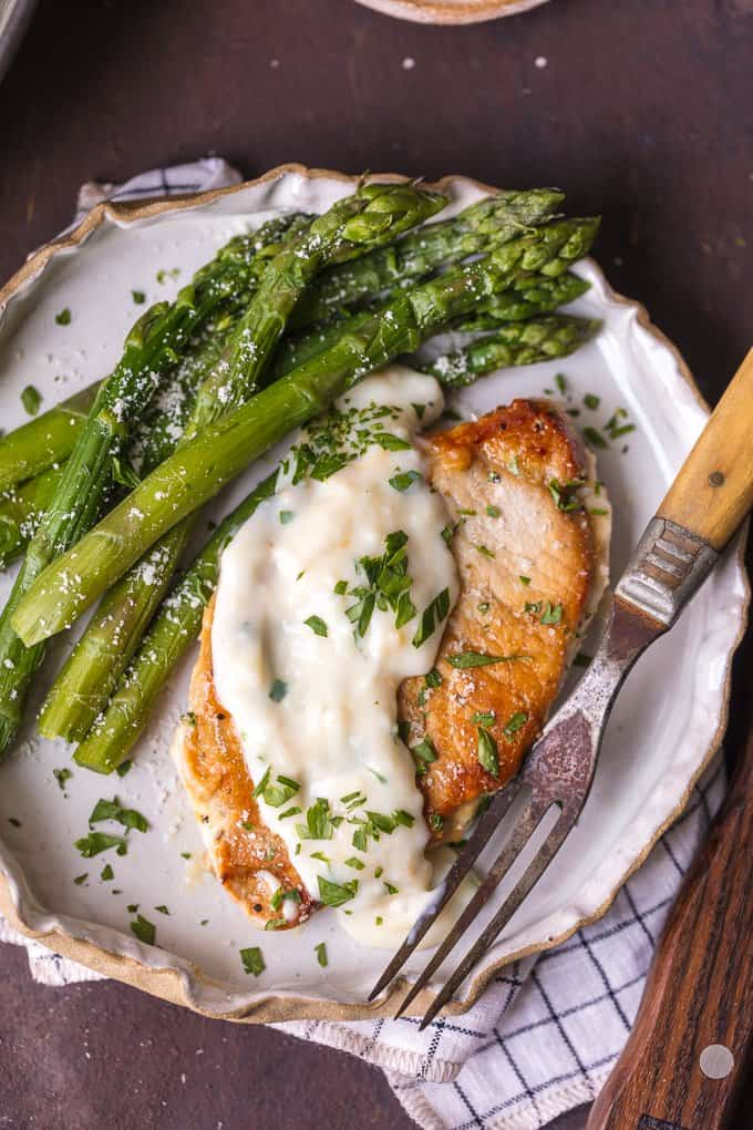 Parmesan Pork Chops with Creamy Parmesan Garlic Sauce and asparagua