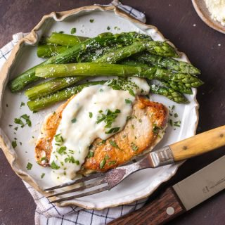 These CREAMY GARLIC PARMESAN PORK CHOPS are easy, made in ONE PAN, and so delicious. The ultimate comfort food!