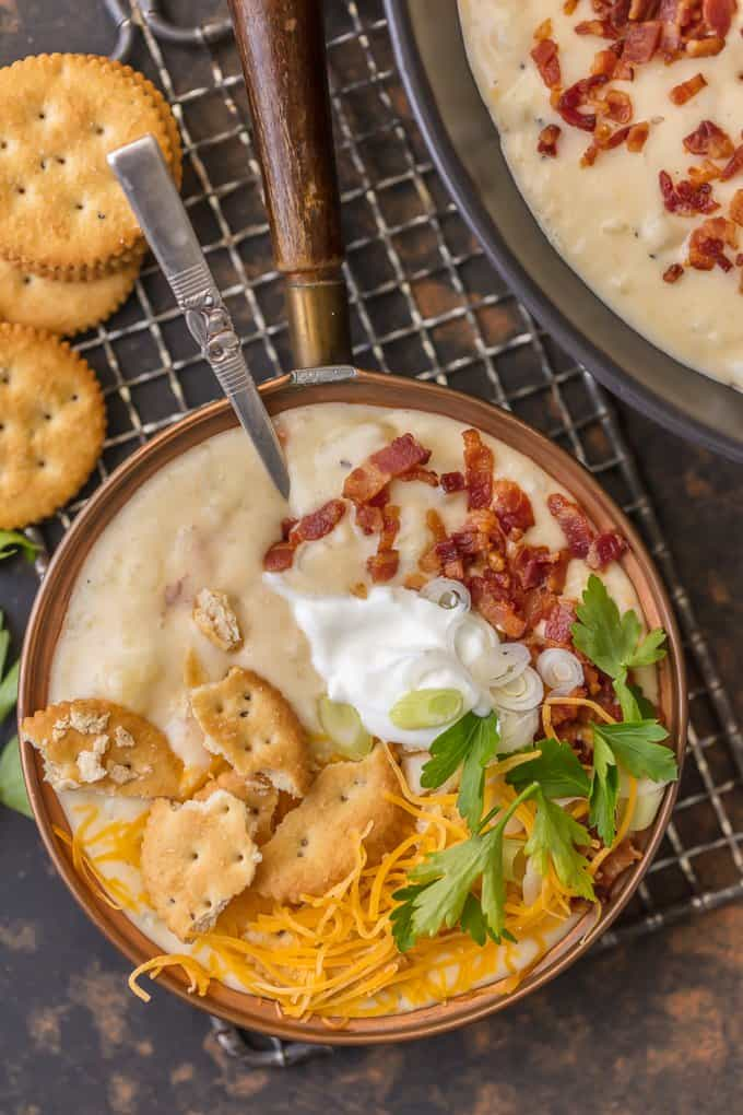 Loaded Baked Potato Soup is one of the best comfort food soups for a cold Winter night! It doesn't get more comforting than this LOADED BAKED POTATO SOUP RECIPE. This creamy hearty potato soup is loaded with bacon, potatoes, cheese, sour cream, and so much more. Loaded Potato Soup warms the soul.