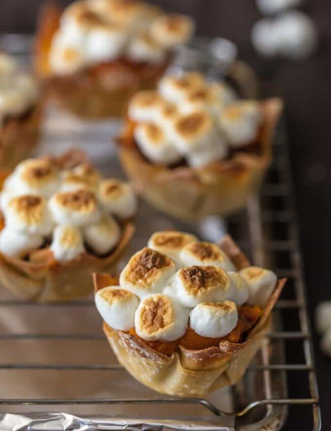Wow your Thanksgiving guests with MINI SWEET POTATO SOUFFLE CUPS! It doesn't get cuter than wonton cups stuffed with sweet potato souffle and topped with toasted marshmallows.