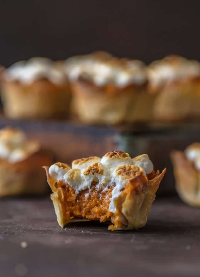 A mini sweet potato souffle cup with a bite taken out of it
