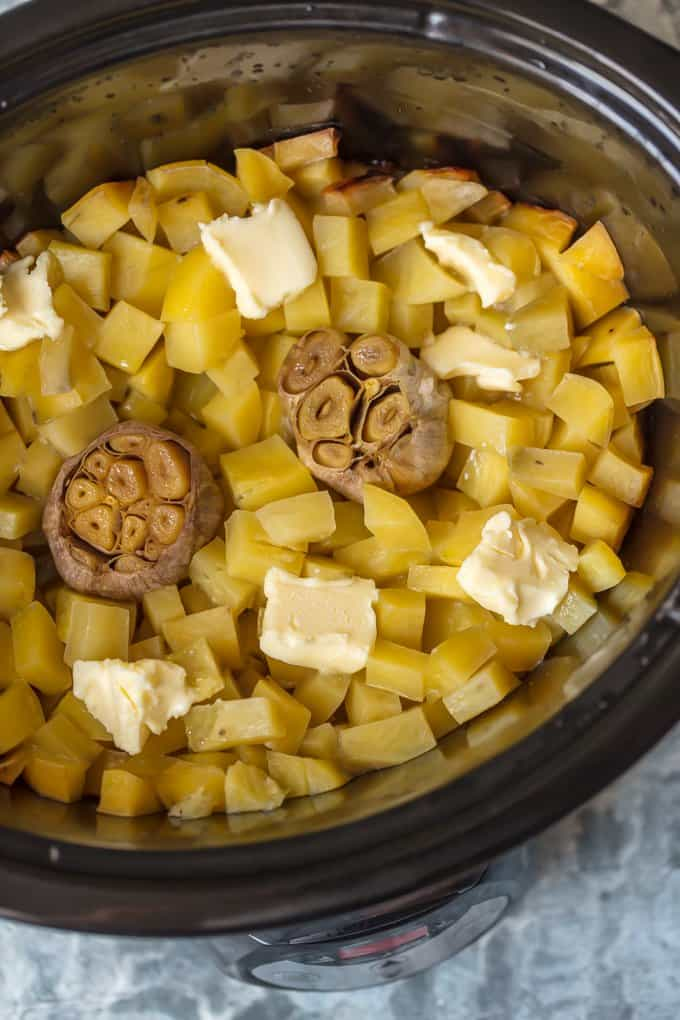 Potatoes, garlic, and butter in a crock pot