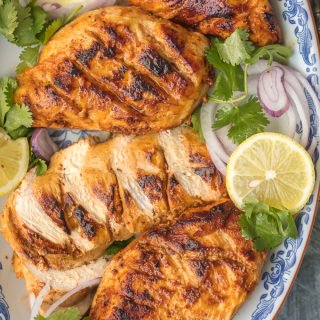 "This ""SMOKED"" SKILLET TANDOORI CHICKEN is loaded with so much flavor you'll swear you used a smoker. Such a fun hack for a delicious and unique dinner at home."