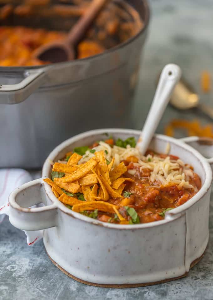 Vegetarian Chili topped with tortilla strips, cilantro, and cheese