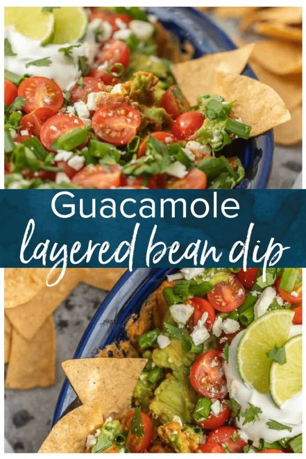 This CRAZY GOOD GUACAMOLE BEAN DIP is layered with spicy refried beans, guacamole, green onion, tomatoes, feta, and more. SO delicious and made in minutes! We LOVE this layered bean dip recipe!