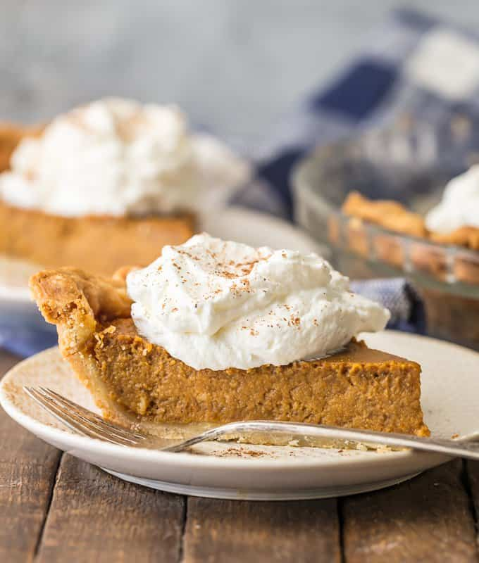slice of pumpkin pie on a white plate
