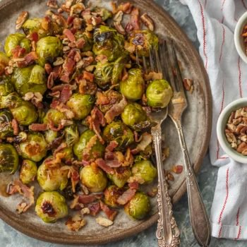 brussel sprouts on a plate with bacon and pecans