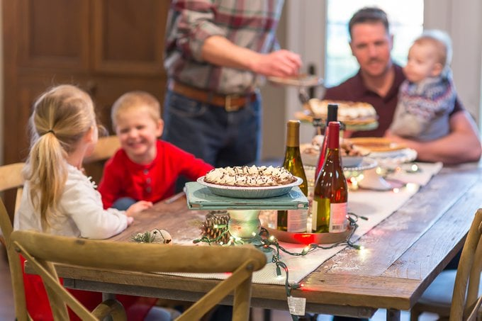 adults and children sitting around a table at a HOLIDAY PIE PARTY