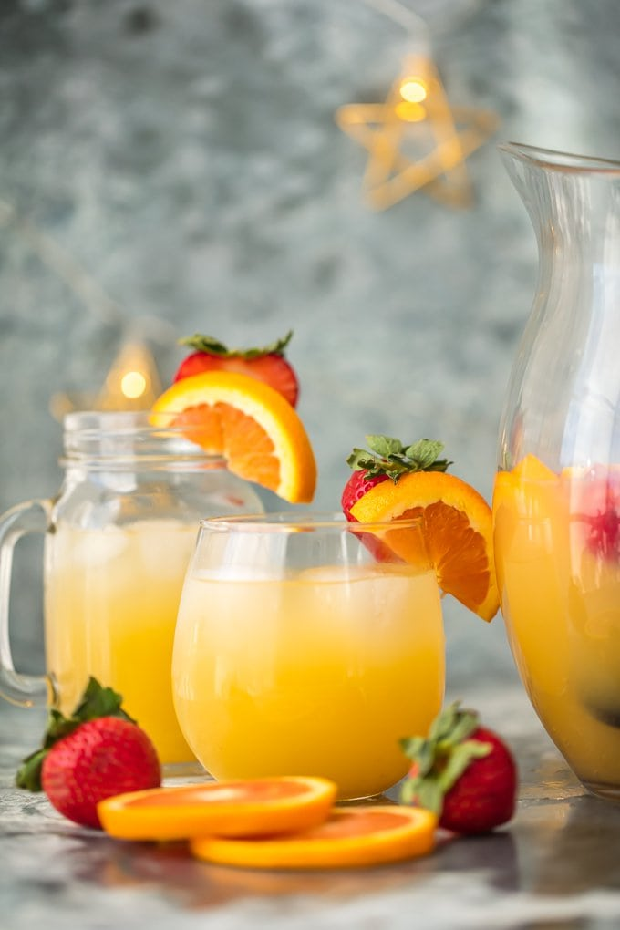 This FESTIVE GRAPEFRUIT BEER SANGRIA is simple, delicious, and so pretty! Grapefruit Shandy, orance juice, and ginger ale is all you need. Garnish with fruit and you're in business!