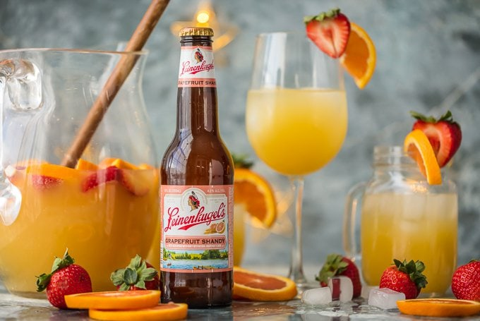 grapefruit beer sangria in glasses with a bottle of grapefruit beer