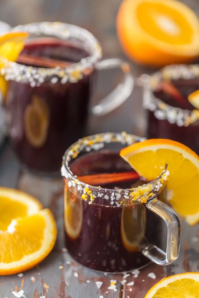 SPICED MULLED WINE MARGARITAS in clear cocktail glasses rimmed with sugared orange zest and orange slices