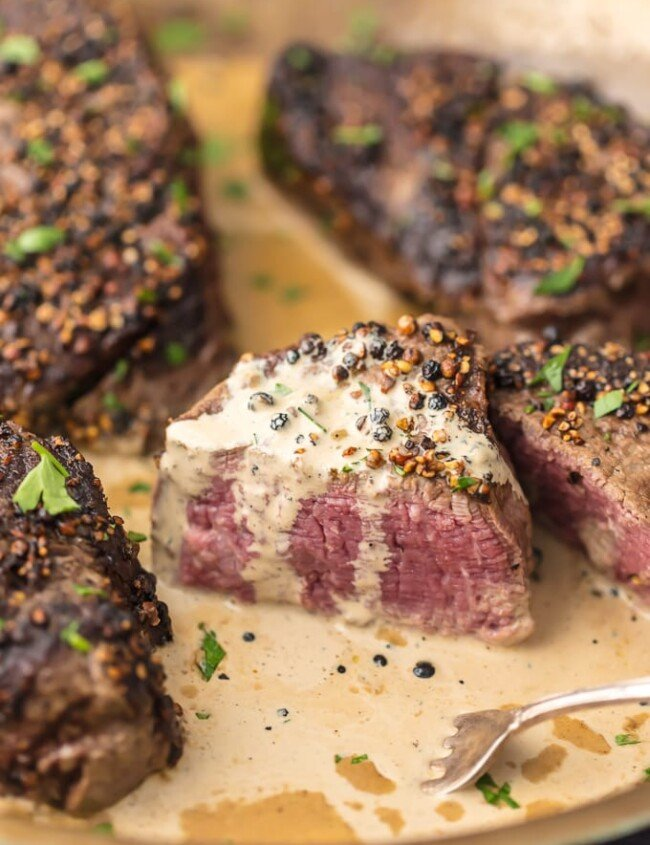 This BEST EVER SKILLET STEAK is smothered in a Peppercorn Cream Sauce fit for a king. This restaurant style steak is so easy to perfect right in your own home. The only way we cook filet mignon!