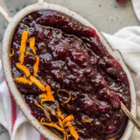 "This Homemade Cranberry Sauce Recipe with Orange Liqueur is our favorite fresh cranberry sauce to make for Thanksgiving! This SPIKED CRANBERRY SAUCE is a fun twist on a classic Thanksgiving recipe. No holiday table is complete without cranberry sauce, and this easy Homemade Cranberry Sauce is extra delicious and amazing! We call them ""sauced"" cranberries."