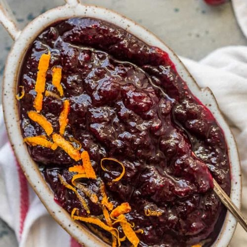 """This Homemade Cranberry Sauce Recipe with Orange Liqueur is our favorite fresh cranberry sauce to make for Thanksgiving!This SPIKED CRANBERRY SAUCE is a fun twist on a classic Thanksgiving recipe. No holiday table is complete without cranberry sauce, and this easy Homemade Cranberry Sauce is extra delicious and amazing! We call them """"sauced"""" cranberries."""