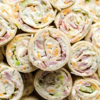 side view of several ham and cheese roll ups