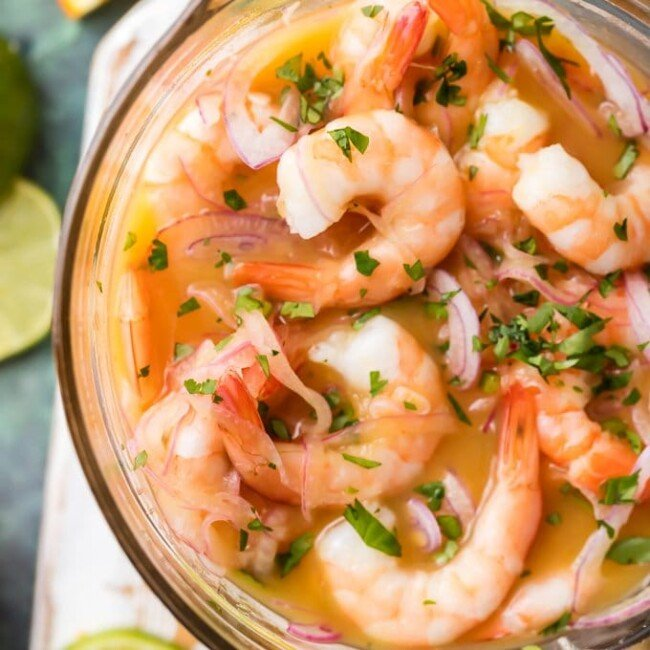 Shrimp Ceviche (Ceviche de Cameron) is a fresh and delicious seafood appetizer. This CEVICHE STYLE SHRIMP COCKTAIL is our favorite light and healthy appetizer for the holidays. This gorgeous seafood starter is bursting with flavor and sure to please. This Shrimp Ceviche Recipe is ULTIMATE NYE APPETIZER!