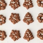 Spritz Cookies are a must make for Christmas. You'd never guess that these CHOCOLATE SPRITZ COOKIES are GLUTEN FREE! Utterly delicious, like little heavenly brownie bites. This Spritz Cookie Recipe is the ultimate EASY Christmas cookie recipe!