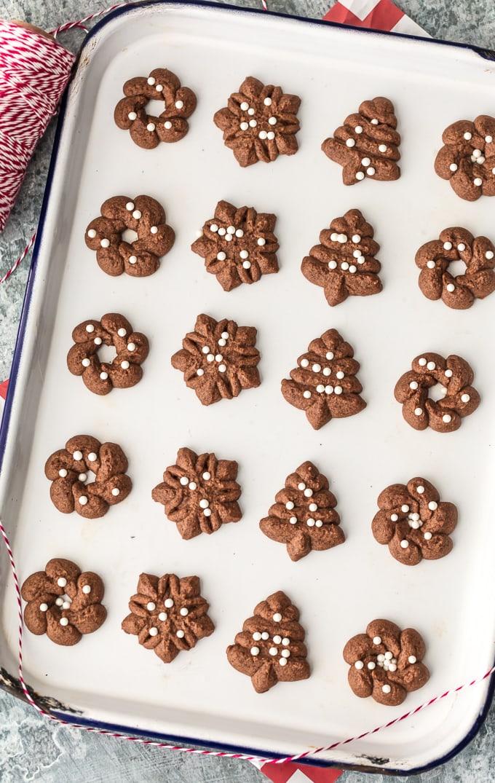 Spritz cookies arranged on a baking sheet