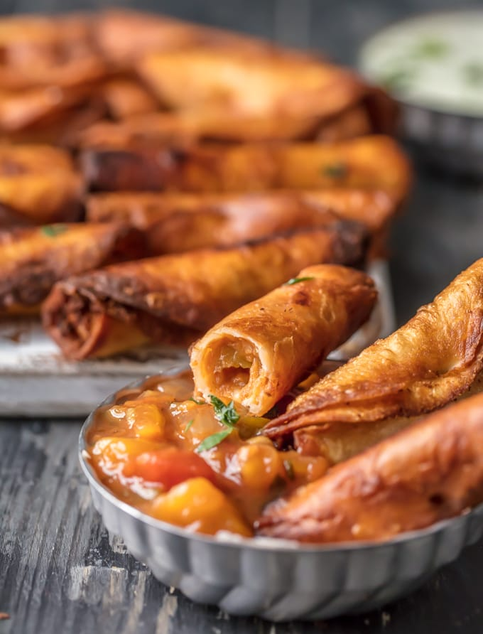 I could eat 50 of these MINI GREEN CHILE CHEESY BEAN TAQUITOS! I just can't get enough. Such a fun and easy appetizer for the holidays or game day. These are always a crowd pleaser.