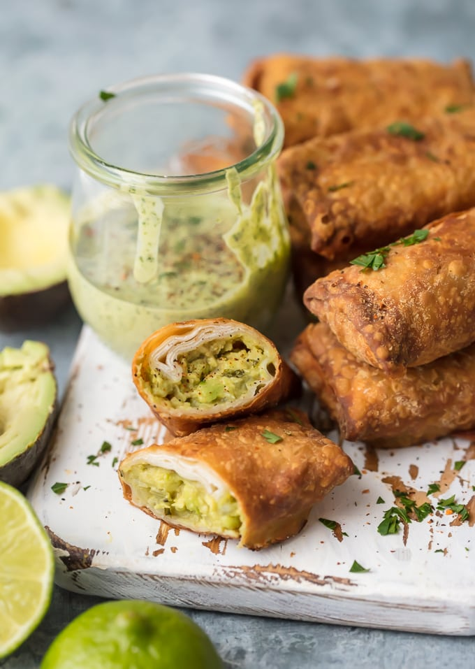 Avocado Egg Rolls on white serving board