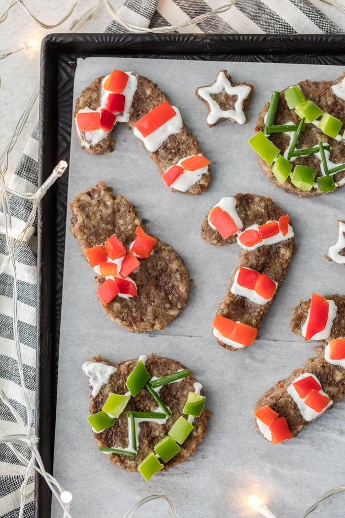 "sheet pan of Sausage ""cookies"" - breakfast sausage shaped with cookie cutters and decorated with red and green peppers"