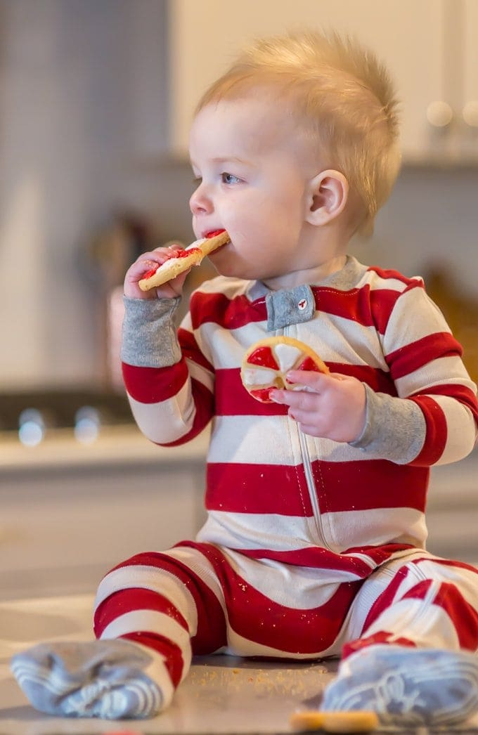Cute baby eating the best sugar cookie recipe
