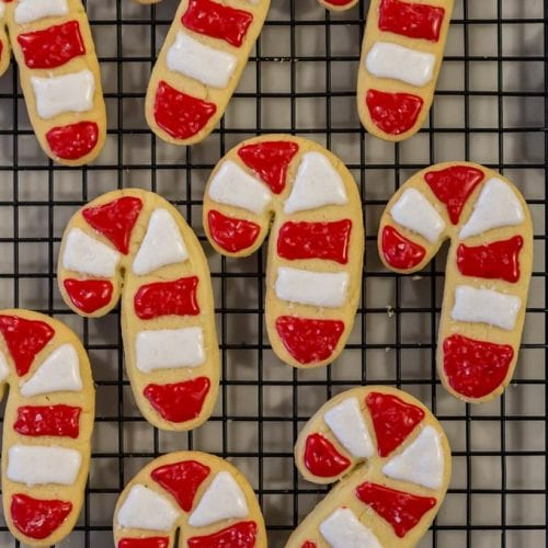 The BEST Sugar Cookie Recipe (aka Santa's favorite cookies) are soft sugar cutout cookies, festively decorated with sweet icing. This Easy  Sugar Cookie Recipe checks all the boxes! We call this easy sugar cookie recipe SANTA'S FAVORITE COOKIE RECIPE because it's simple, classic, fluffy, and delicious. We love to decorate them with the kids to leave under the tree for Santa.