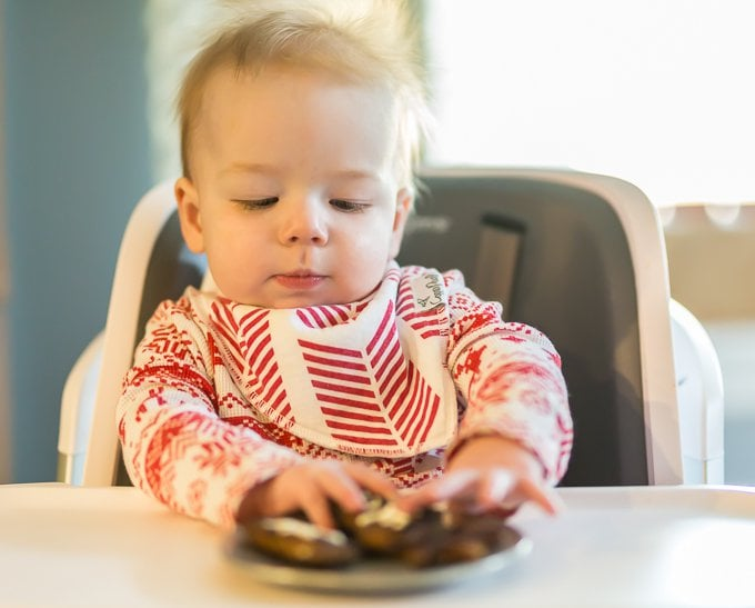 "blonde haired baby boy eating breakfast sausage ""cookies"""