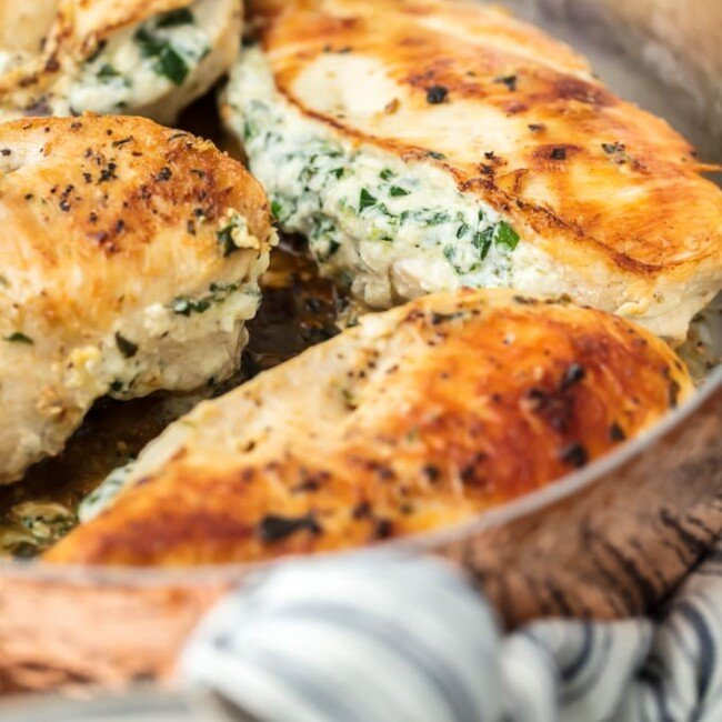 Spinach Stuffed Chicken Breast is a 3 INGREDIENT CHICKEN RECIPE that's healthy (around 400 calories), made in under 30 minutes, and done in just ONE PAN! This Spinach Stuffed Chicken Breast is one of our all-time favorite Stuffed Chicken Breast Recipes. Cheesy, delicious goodness.