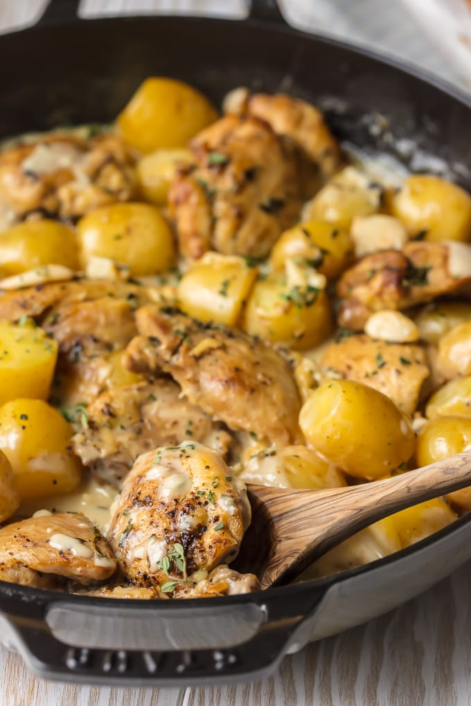 Close up of garlic chicken and potatoes in skillet