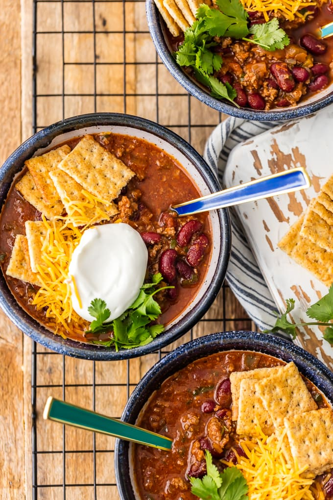Best Easy Chili Recipe topped with crackers, sour cream, and cheese