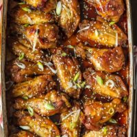 These SESAME BAKED WINGS are my go-to sticky wings recipe for game day. A little bit spicy and a little bit sweet, they're loved by all. You'll never miss deep frying your wings after you taste how amazing baked wings are!