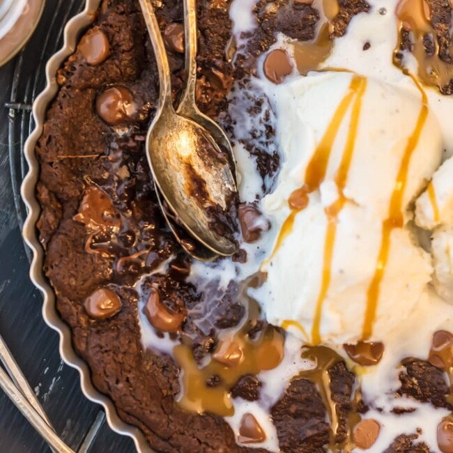This GIANT COOKIE RECIPE is perfect for SHARING! Similar to those incredible skillet cookies you find at restaurants, our giant CHOCOLATE CARAMEL COOKIE recipe is the stuff dreams are made of! This is our favorite oh so decadent dessert to make for any and every celebration. Gooey chocolate caramel cookies for the win!