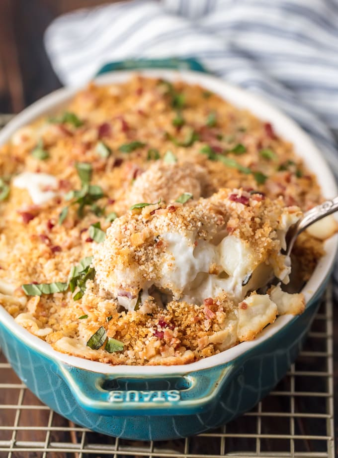 a scoop of Cheesy Bacon Gnocchi Bake in a blue baking dish
