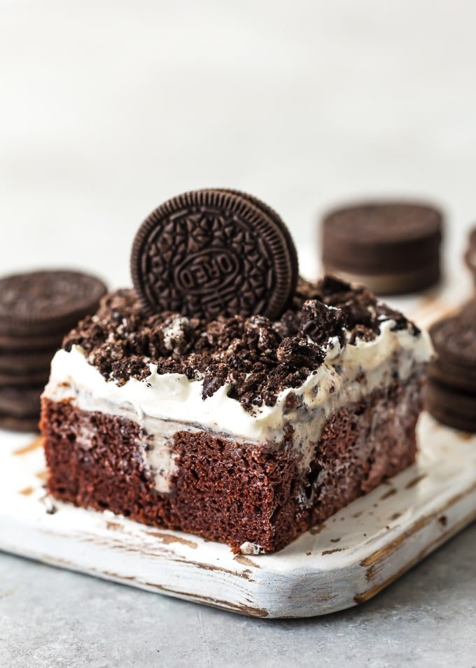 This CREAMY OREO POKE CAKE RECIPE is one of our favorite EASY and delicious cakes to throw together for any occasion. This moist and flavorful cookies and cream cake is layered with chocolate cake, Oreo pudding, cool whip, and crushed Oreos! It's the perfect OREO CAKE RECIPE for birthday parties, holiday get togethers, or for celebrating making it to Friday. So good!