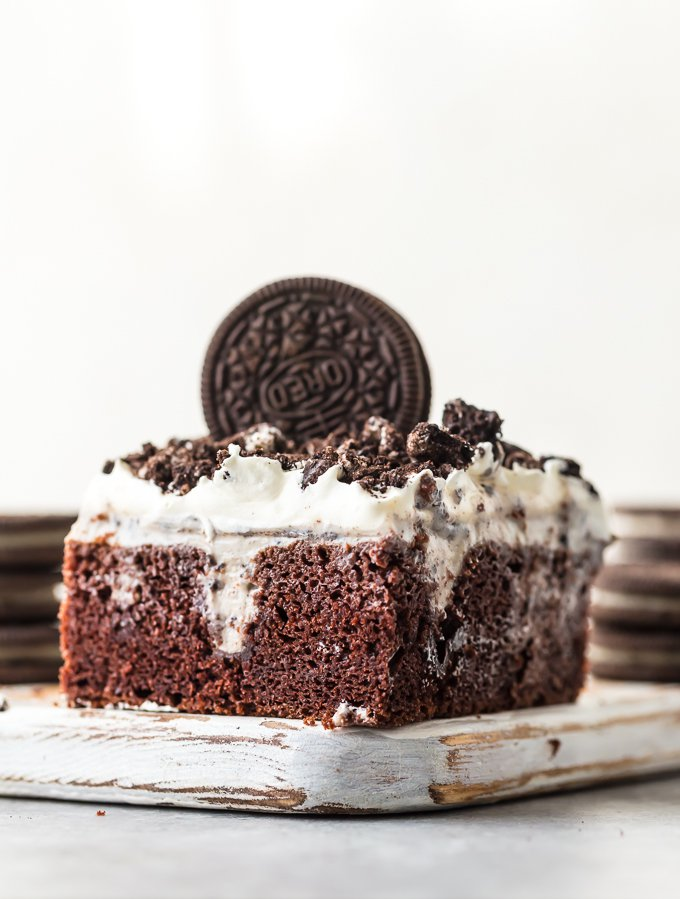 This CREAMY OREO POKE CAKE is one of our favorite EASY and delicious cakes to throw together for any occasion. This moist and flavorful cake is layered with chocolate cake, oreo pudding, cool whip, and crushed oreos! Perfect for birthday parties, holiday get togethers, or for celebrating making it to Friday. So good!
