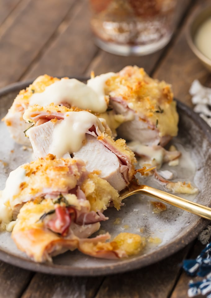 Easy Chicken Cordon Bleu with the BEST Chicken Cordon Bleu Sauce EVER is my favorite recipe for entertaining a crowd. Instead of spending time rolling and stuffing, this Chicken Cordon Bleu Recipe has layers of chicken, ham, cheese, bread crumbs, and is delicious white wine dijon sauce. Get ready to learn how to make Chicken Cordon Bleu as well as what to SERVE with Chicken Cordon Bleu. Best easy chicken recipe ever.